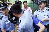 Imagem ilustrativa. Song Enguang evangelizou policiais enquanto era espancado, na China. (Foto: Reprodução)
