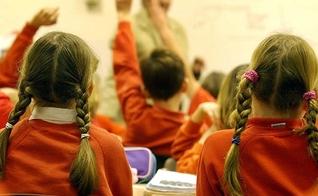 Crianças na Escola. (Foto: Getty Images)