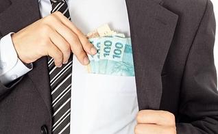 Dinheiro e corrupção. (Foto: Getty)