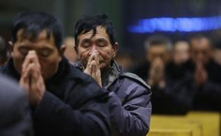 Cristão chinês em momento de oração em Xiliulin, na China. (Photo: CNS)