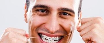 Aprenda a maneira certa de usar o fio dental