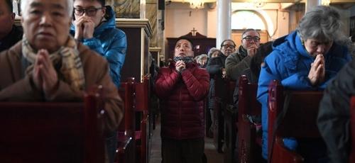 Apesar da perseguição religiosa, o cristianismo cresce exponencialmente na China. (Foto: AFP via Getty Images)
