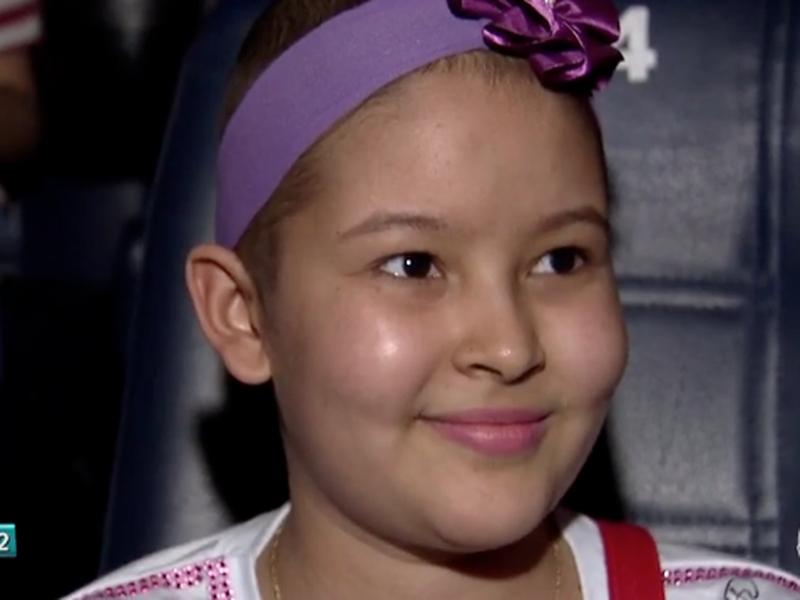 Rayane e outras crianças com câncer foram ao cinema em Campo Grande. (Foto: Reprodução/TV Morena)