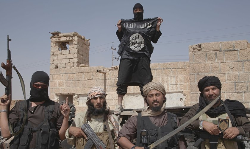 Terroristas do Estado Islâmico. (Foto: Corbis/Medyan Dairieh)