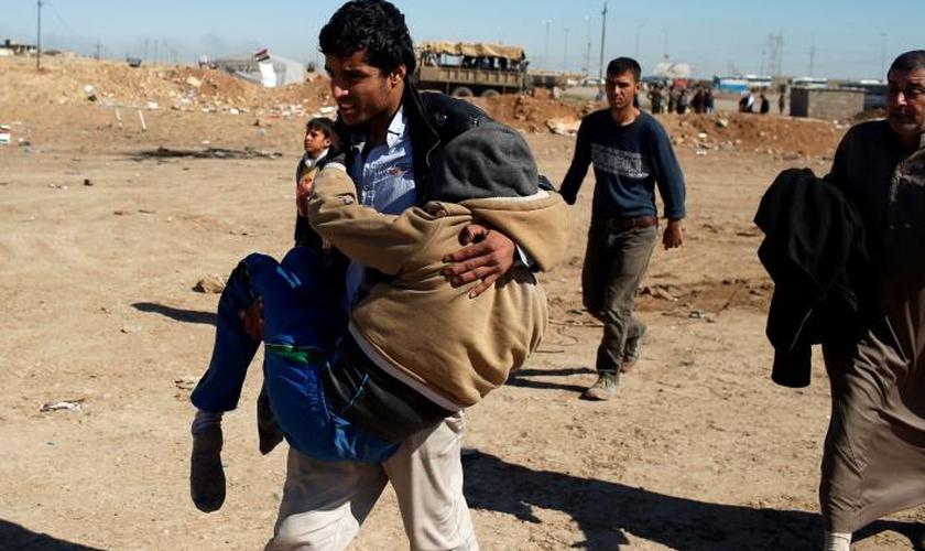 Mahmoud foi salvo por cristãos durante sua fuga do Estado Islâmico. (Foto: Reuters).