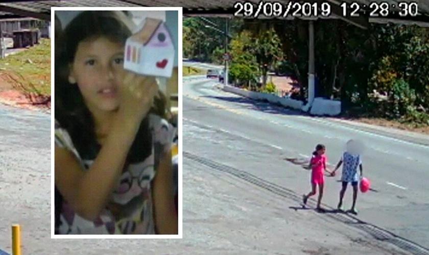 A menina Raíssa de mãos dadas com adolescente, em Perus. (Foto: Reprodução/TV Globo)