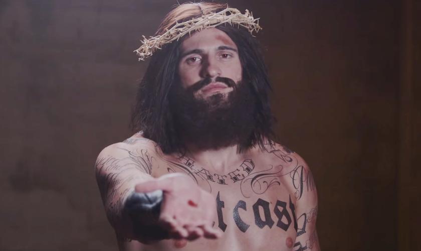 """ídeo oficial do projeto """"Jesus Tattoo"""", onde Jesus Cristo é representado como um tatuador que cura seus clientes."""