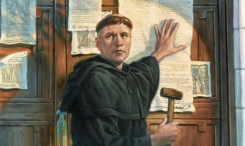 Pintura ilustra o momento em que Martinho Lutero prega na porta da Igreja de Wittenberg, as 95 teses da Reforma Protestante. (Imagem: ANSA Brasil)